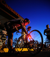 John Grahm of Fond du Lac, adjusts the light on his bike before lining up with his flight for the annual Race the Lake Event. Mr. Graham was riding with Team 67, in honor of local police officer Craig Birkholz.  Sunday, August 18, 2013. Patrick Flood/Action Reporter Media.