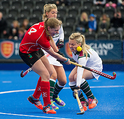 Surbiton's Hollie Webb deflects Lizzie Neal's shot into her cheek. Canterbury v Surbiton - Investec Women's Hockey League Championship Final, Lee Valley Hockey & Tennis Centre, London, UK on 19 April 2015. Photo: Simon Parker