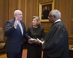 April 25, 2017 - Washington, DC, United States of America - Former Georgia Gov. Sonny Perdue, left, is sworn in as the 31st U.S. Secretary of Agriculture by Supreme Court Clarence Thomas as his wife Mary looks on April 25, 2017 in Washington, DC. After the ceremony Perdue spoke with USDA employees and then began his first day at the job. (Credit Image: © Ken Hammond/Planet Pix via ZUMA Wire)