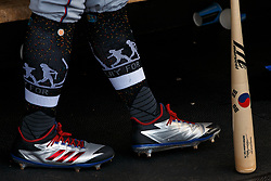 SAN FRANCISCO, CA - AUGUST 24: Detailed view of socks and baseball cleats worn by Shin-Soo Choo #17 of the Texas Rangers for player's weekend in the dugout before the game against the San Francisco Giants at AT&T Park on August 24, 2018 in San Francisco, California. The Texas Rangers defeated the San Francisco Giants 7-6 in 10 innings. (Photo by Jason O. Watson/Getty Images) *** Local Caption *** Shin-Soo Choo