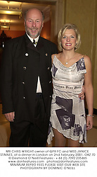 MR CHRIS WRIGHT owner of QPR FC and MISS JANICE STINNES, at a dinner in London on 2nd February 2001.	OKZ 70