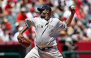 ANAHEIM, CA - JULY 12:  Starting pitcher C.C. Sabathia #52 of the New York Yankees throws a pitch during the game against the Los Angeles Angels of Anaheim at Angel Stadium on Sunday, July 12, 2009 in Anaheim, California.  The Angels defeated the Yankees 5-4 and swept the three game series.  (Photo by Paul Spinelli/MLB Photos via Getty Images)  *** Local Caption *** C.C. Sabathia