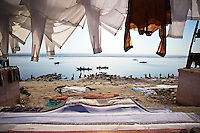 Looking out to the ganges river on a calm day with cloths drying