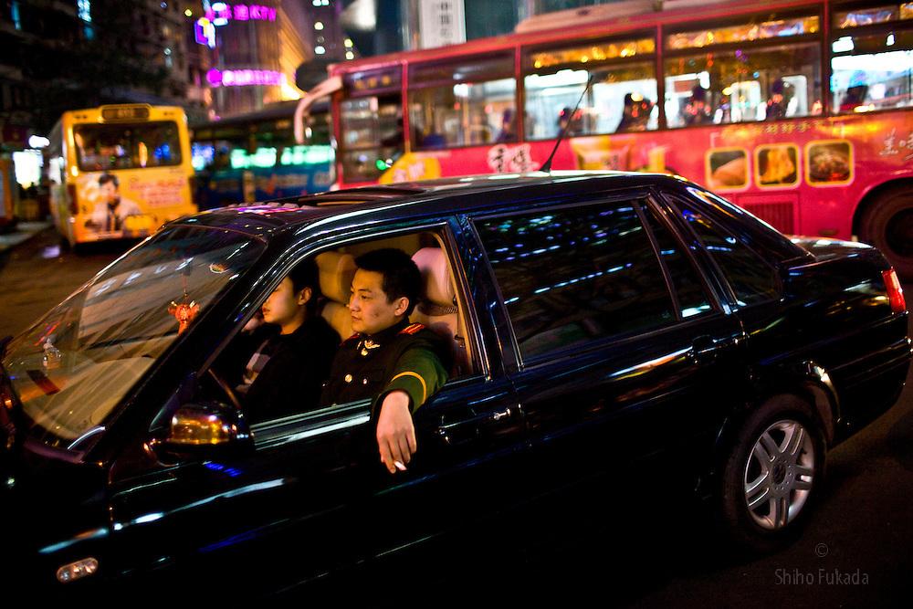 People enjoy night life in Chongqing, China, March 3, 2009.