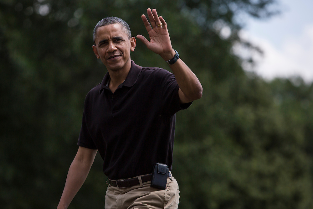 President Barack Obama arrives at the White House after spending the night at Camp David on Sunday, August 5, 2012 in Washington, DC.