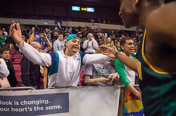 Huntington forward Jeffrey Howard (23) celebrates winning the Class AAA championship game at the Charleston Civic Center.