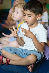 Nursery school children developing early numeracy skills through singing and stories,