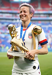 USA's Megan Rapinoe celebrates with her adidas Golden Boot award, adidas Golden Ball award, and Fifa Women's World Cup Trophy after the final whistle