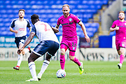 Rochdale midfielder Matt Done challenged by Bolton Wanderers defender Josh Emmanuel during the EFL Sky Bet League 1 match between Bolton Wanderers and Rochdale at the University of  Bolton Stadium, Bolton, England on 19 October 2019.