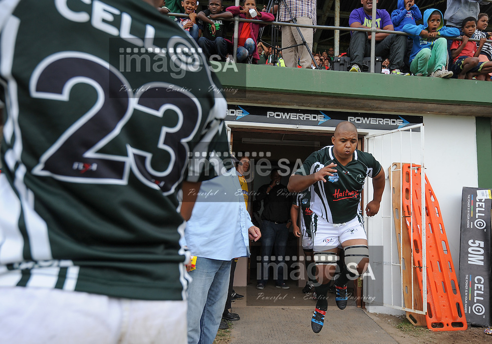 GEORGE, SOUTH AFRICA - Saturday 7 March 2015, Marvin November, captain of Pacaltsdorp Evergreens leads his team on to the field during the third round match of the Cell C Community Cup between Pacaltsdorp Evergreens and Vaseline Wanderers at Pacaltsdorp Sports Grounds, George<br /> Photo by Roger Sedres/ImageSA/ SARU