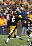 15 NOVEMBER 2008: Iowa punter Ryan Donahue (5) kicks a 36 yard punt in the second half of an NCAA college football game against Purdue, at Kinnick Stadium in Iowa City, Iowa on Saturday Nov. 15, 2008. Iowa beat Purdue 22-17.