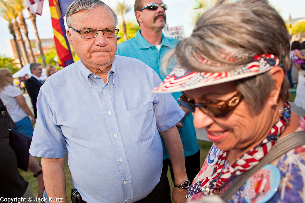 15 APRIL 2011 - PHOENIX, AZ: Maricopa County Sheriff JOE ARPAIO, a staunch opponent of illegal immigration and favorite of the Tea Party movement, meets with supporters in Phoenix Friday. About 500 supporters of the Tea Party movement rallied Friday at the Arizona State Capitol to mark tax day. They protested high taxes, the federal deficit, the debt limit and immigration policy. About 50 pro-immigrant protesters held a counter rally at the capitol. At least one person was arrested, and others led away by police after several shouting matches between Tea Party supporters and the immigrants rights protesters broke out.     Photo by Jack Kurtz