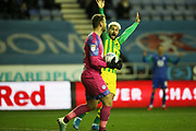West Bromwich Albion forward Charlie Austin (15) appeals for the free kick as Wigan Athletic goalkeeper Jamie Jones (23) picks up from the backpass during the EFL Sky Bet Championship match between Wigan Athletic and West Bromwich Albion at the DW Stadium, Wigan, England on 11 December 2019.
