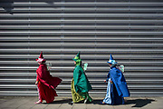 UNITED KINGDOM, London: 27-28 May 2017 Cosplay fans dressed as The Three Good Faires from Sleeping Beauty walk to the MCM London Comic Con. <br /> The comic convention, which will be visited by tens of thousands of comic book and cosplay fans, is being held at London's ExCel this weekend. Rick Findler / Story Picture Agency