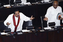 November 19, 2018 - Colombo, Sri Lanka - Newly appointed Sri Lankan Prime Minister and former president  Mahinda Rajapaksa (L) is seen during a special parliamentary session at the Parliamentary complex, Colombo, Sri Lanka on 19 November 2018. Following a stay order issued by the Sri Lankan Supreme Court effective till 07 December 2018, Sri Lankan Parliament was reconvened on 14. (Credit Image: © Tharaka Basnayaka/NurPhoto via ZUMA Press)