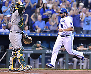 April 13, 2017 - Kansas City, MO, USA - The Kansas City Royals' Mike Moustakas (8) scores on a single by Salvador Perez in the first inning against the Oakland Athletics at Kauffman Stadium in Kansas City, Mo., on Thursday, April 13, 2017. (Credit Image: © John Sleezer/TNS via ZUMA Wire)