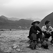 Men wait to sell piglets at a market in Ha Giang, Vietnam's northernmost province.