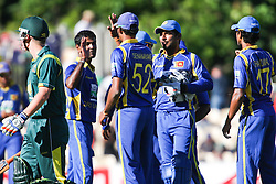 © Licensed to London News Pictures. 08/03/2012. Adelaide Oval, Australia. The Sri Lankans celebrate the last wicket of  Nathan Lyon, getting Australia all out for 231 during the One Day International cricket match final between Australia Vs Sri Lanka. Photo credit : Asanka Brendon Ratnayake/LNP