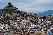 A ruined shrine among debris in the city of Ishinomaki, Miyagi prefecture, Japan Friday May 6th 2011. Ishinomaki bore the brunt of the magnitude 9 earthquake that struck the Tohoku coast on March 11th and the town was almost completely destroyed by the large tsunami that followed the quake 20 minutes later