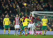Norwich City's Jamal Lewis and Sheffield United's Leon Clarke during the EFL Sky Bet Championship match between Norwich City and Sheffield Utd at Carrow Road, Norwich, England on 20 January 2018. Photo by John Marsh.