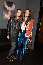 Left to right, Charlotte de Carle and Iraira Mancini at an exhibition of photographs by Erica Bergsmeds held at The Den, 100 Wardour Street, London England. 19 January 2017.