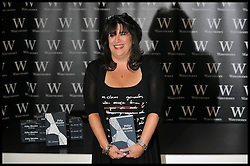 Author E L James attends her book signing at Waterstones, Piccadilly, London, author of Fifty Shades Of Grey author meets her fans as she signs copies of her bestselling novel, Thursday September 6, 2012 Photo Andrew Parsons/i-Images..All Rights Reserved ©Andrew Parsons/i-Images