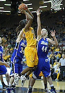 December 20, 2011: Iowa Hawkeyes guard Theairra Taylor (23) puts up a shot between Drake Bulldogs guard Amber Wollschlager (34) and Drake Bulldogs forward/center Stephanie Running (44) during the NCAA women's basketball game between the Drake Bulldogs and the Iowa Hawkeyes at Carver-Hawkeye Arena in Iowa City, Iowa on Tuesday, December 20, 2011. Iowa defeated Drake 71-46.