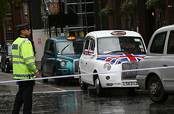 © Licensed to London News Pictures. 05/10/2015. London, UK.  Black taxi cab drivers surround Transport for London's headquarters in an ongoing protest. Photo credit: Peter Macdiarmid/LNP