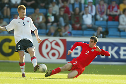 OSLO, NORWAY - Thursday, May 27, 2004:  Wales' Mark Delaney and Norway's John Arne Riise during the International Friendly match at the Ullevaal Stadium, Oslo, Norway. (Photo by David Rawcliffe/Propaganda)