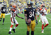 Pittsburgh Steelers running back DeAngelo Williams (34) laughs and celebrates after catching a 4 yard fourth quarter touchdown pass that gives the Steelers a 24-9 lead during the 2016 NFL week 2 regular season football game against the Cincinnati Bengals on Sunday, Sept. 18, 2016 in Pittsburgh. The Steelers won the game 24-16. (©Paul Anthony Spinelli)