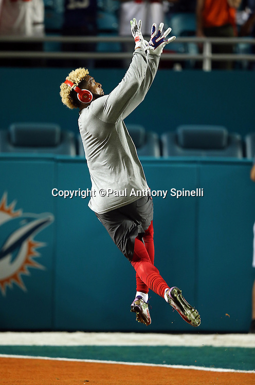 New York Giants wide receiver Odell Beckham Jr. (13) jumps and catches an over the shoulder pass while warming up before the NFL week 14 regular season football game against the Miami Dolphins on Monday, Dec. 14, 2015 in Miami Gardens, Fla. The Giants won the game 31-24. (©Paul Anthony Spinelli)