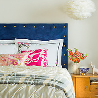 Upholstered headboard in white bedroom