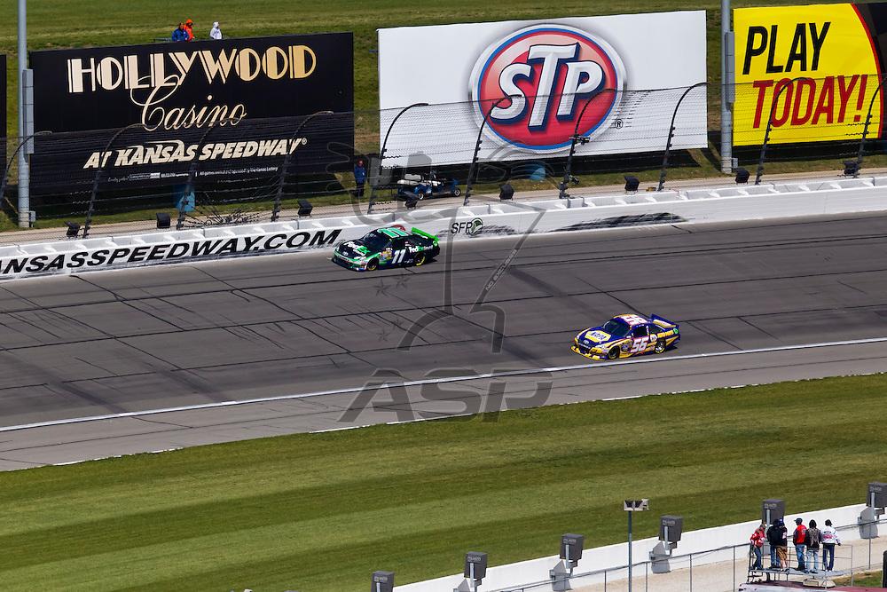 KANSAS CITY, KS - APR 22, 2012:  Denny Hamlin (11) holds off a hard charging field to win the STP 400 at the Kansas Speedway in Kansas City, KS.