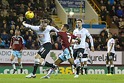 Derby County defender Richard Keogh  with an own goal pressed by Burnley forward Andre Gray  during the Sky Bet Championship match between Burnley and Derby County at Turf Moor, Burnley, England on 25 January 2016. Photo by Simon Davies.