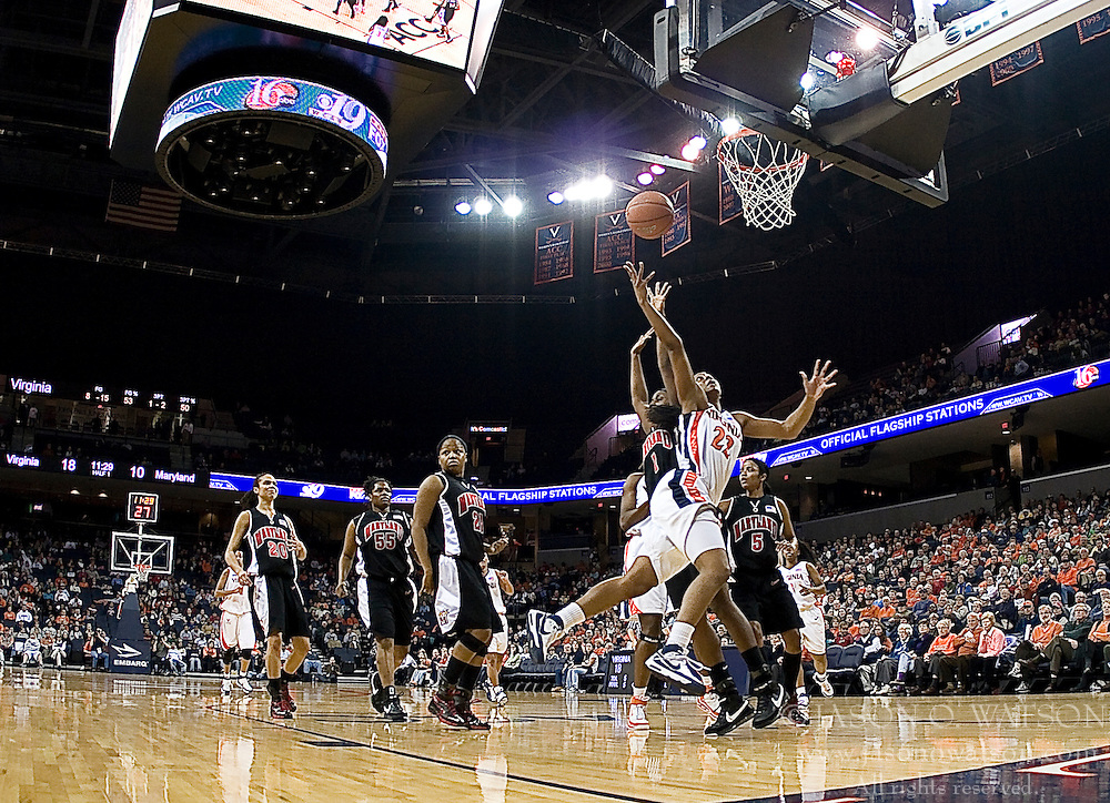 Virginia guard Monica Wright (22) shoots past Maryland forward/center Crystal Langhorne (1).  The Virginia Cavaliers women's basketball team fell to the #4 ranked Maryland Terrapins 74-62 at the John Paul Jones Arena in Charlottesville, VA on January 18, 2008.