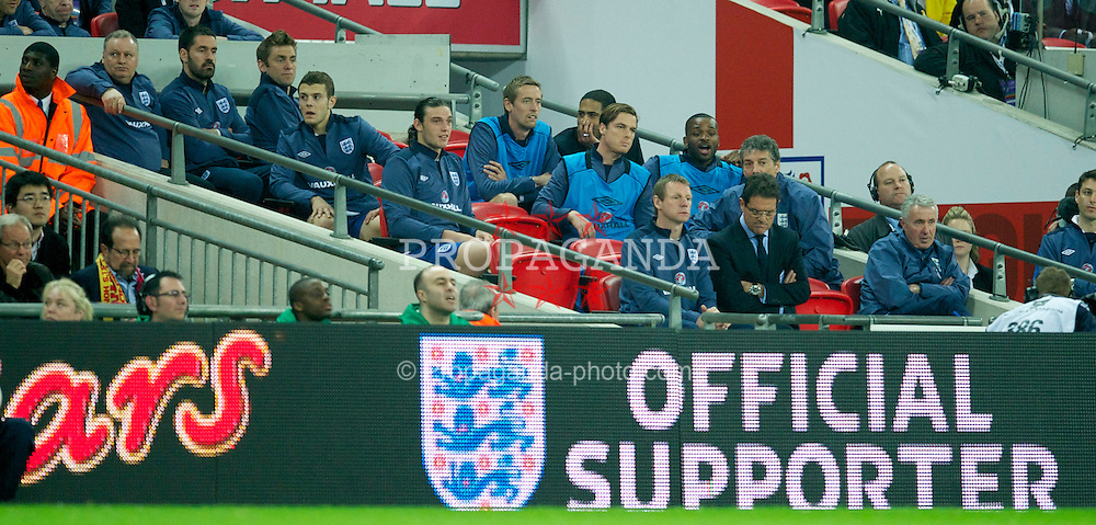 LONDON, ENGLAND - Tuesday, March 29, 2011: England's substitues look bored on the bench behind head coach Fabop Capello during the international friendly match against Ghana at Wembley Stadium. (Photo by David Rawcliffe/Propaganda)