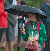 Hamburg. GERMANY. BLR athlete/Supporter hiding from the rain under an umbrella.   Saturday Morning, Semi Finals A/B  at the 2014 FISA Junior World rowing. Championships.  09:58:49  Saturday  09/08/2014  [Mandatory Credit; Peter Spurrier/Intersport-images]