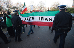 © Licensed to London News Pictures. 02/12/2011. Demonstrators carry a 'Free Iran' banner in front of the Iranian Embassy in London Today (02/12/2011). Diplomats working at the Iranian embassy in London have been given this afternoon as a deadline to leave the UK, after the British embassy in Tehran was stormed. Photo credit: Ben Cawthra/LNP