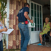 Toa Baja, PR, November 10, 2017--Jes˙s Pag·n Torres and Inamays Carreras NegrÛn are part of a team of faculty and staff of Escuela Delia Cab·n who continue to distribute water and emergency relief in Tao Baja, PR neighborhoods still without power and water 50 days after Hurricane Maria.  Escuela Delia Cab·n has served as a distribution point for the Puerto Rico Recovery Fund's emergency relief efforts since it was established days after the storm hit September 20, 2017.  Photo by Lori Waselchuk/BRAF