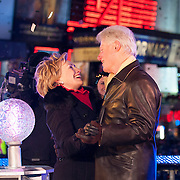 Former President Bill Clinton and Secretary of State Hillary Clinton celebrate the new year during the ceremony to lower the Times Square New Year's Eve ball in Times Square.