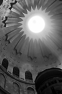 The sun shining through the Rotunda of the  Church of The Holy Sepulcher in Jerusalem. Below the main dome of the Church sits the chapel called the Aedicule containing the tomb.