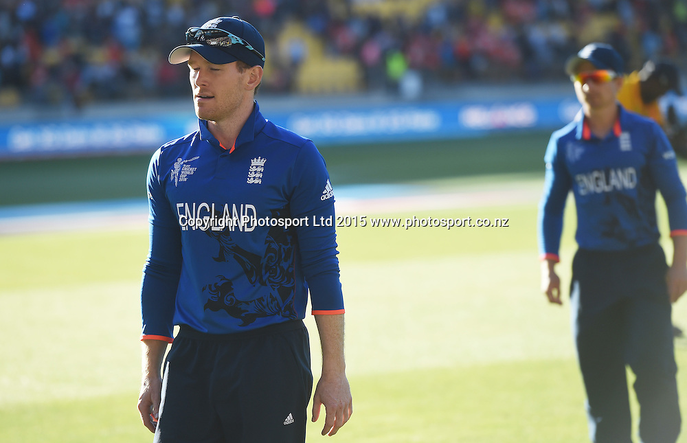 England captain Eoin Morgan leads his team from the field ater an embarrassing defeat to New Zealand at the ICC Cricket World Cup match between New Zealand and England in Wellington, New Zealand. Friday 20 February 2015. Copyright Photo: Andrew Cornaga / www.Photosport.co.nz