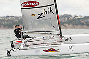 Nathan Outteridge (AUS1004) foils to the finish of race one of the A Class World championships regatta being sailed at Takapuna in Auckland. 11/2/2014