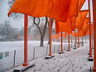 """The Gates,"" by conceptual artists Christo and Jeanne-Claude's which consisted of an installation of 7,500 saffron-colored fabric panels hanging from 16-ft.-tall portals along 23 miles of walkway in Central Park."