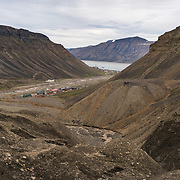 Climbing the moraine of the Larsbreen Glacier, Nybyen in the valley below and in center right a tailing pile from mine 2B.