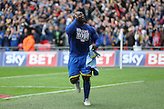 AFC Wimbledon striker Adebayo Akinfenwa (10) celebrating promotion at the end of the Sky Bet League 2 play off final match between AFC Wimbledon and Plymouth Argyle at Wembley Stadium, London, England on 30 May 2016.