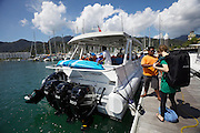 Malaysia, Langkawi. Telaga Harbour. Tourists wboarding the ferry to Ko Lipe.