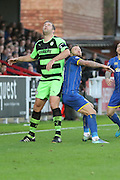Jon Parkin battles with Sean Rigg of AFC Wimbledon during the The FA Cup match between AFC Wimbledon and Forest Green Rovers at the Cherry Red Records Stadium, Kingston, England on 7 November 2015. Photo by Stuart Butcher.