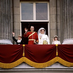 The bride and groom, Princess Anne and Captain Mark Phillips,  wave to the crowds from the balcony of Buckingham Palace after their wedding at Westminster Abbey, London. They are joined by the Bridesmaid, Lady Sarah Armstrong-Jones and the Page-Boy, Prince Edward.