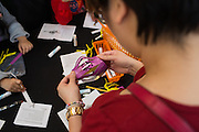 Visitors make arts and crafts during the Chinese New Year celebration at the Great Mall of the Bay Area in Milpitas, California, on February 13, 2016. (Stan Olszewski/SOSKIphoto)